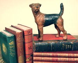 an Airedale with Watson's Dog Book and Leighton's the Book(s) of the Dog
