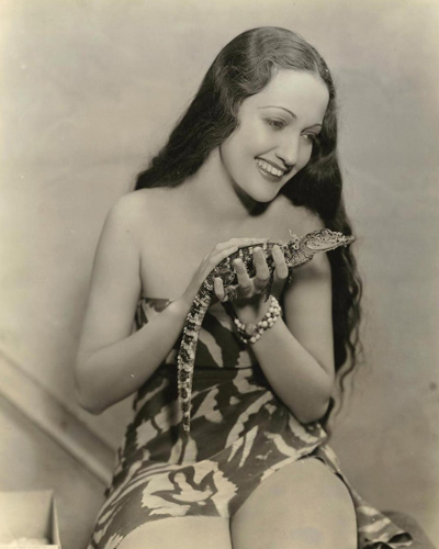 A still of Dorothy Lamour (who was crowned Miss New Orleans in 193) with her baby crocodile during the production of The Jungle Princess.