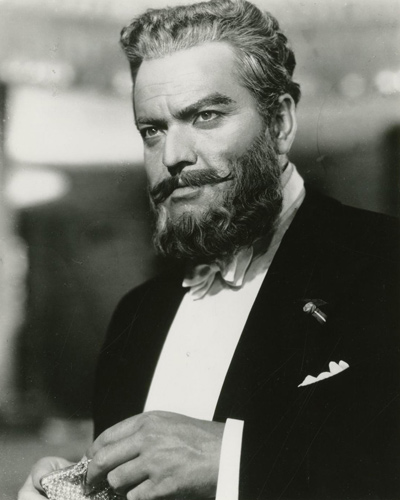 Collection of 5 vintage single weight photographs from the UK release of the 1955 film. Three of the photos feature the film's star, Orson Welles.