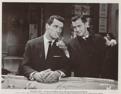 Signed Rock Hudson publicity photo for film Pillow Talk, where Tony Randall is lighting Hudson's cigarette