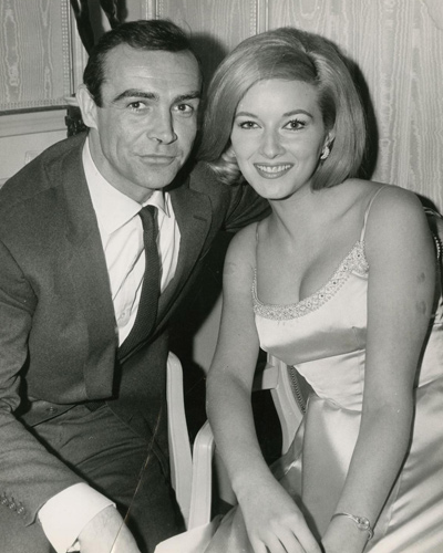 Vintage borderless black-and-white candid press photograph taken at an event on March 28, 1963, where Sean Connery met the