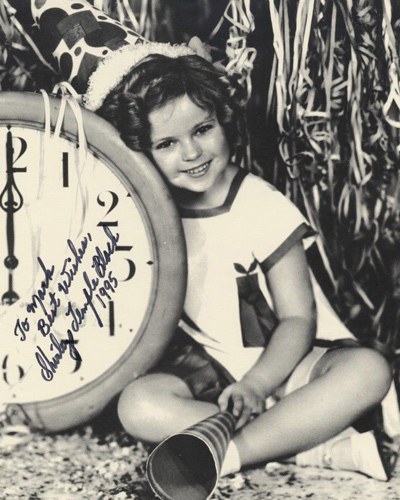 Black and white 8 X 10 photograph inscribed To Mark / Best Wishes / Shirley Temple Black / 1995 in black ink.