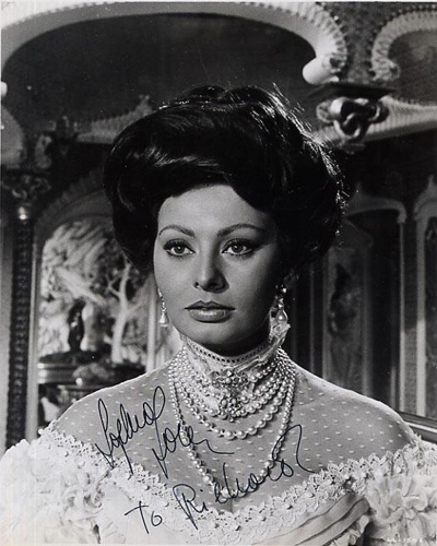 A close-up b&w 8 x 10 portrait of Sophia Loren from Lady L? that has been inscribed and signed by Loren.