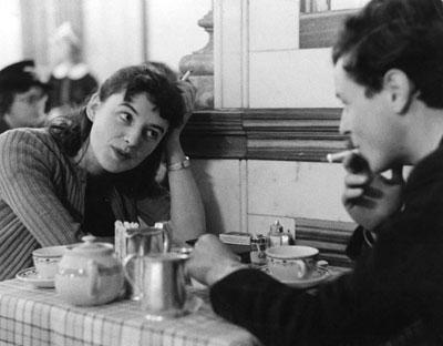Photographed by Emil Otto Hoppe, this image is titled 'Tragedy Or Comedy? A Tea Shop Tete a Tete, Talking Things Over.'