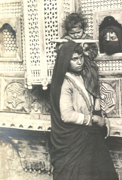 In Egypt, a Coptic woman is photographed in 1900.