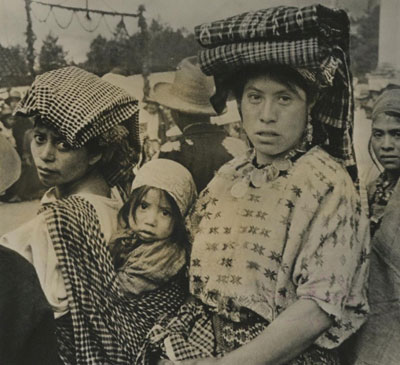 In 1968, Guatemalan women go to market.