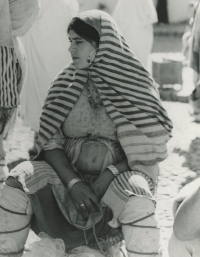 In Morocco, a Berber woman sits in the market circa 1960s.